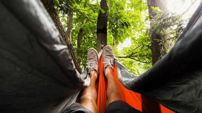 Man's legs in hammock