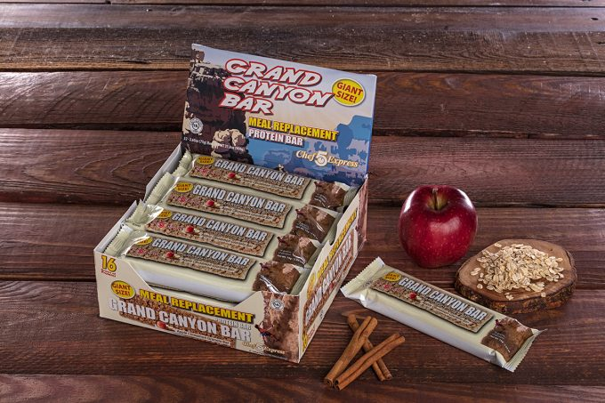 Protein bars on wooden background