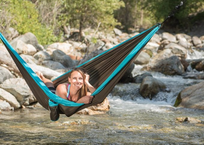 Relaxing in hammock over river
