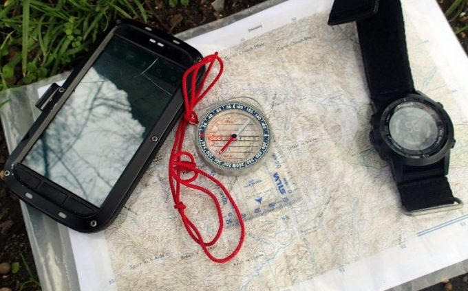 compass, map, cellphone and GPS watch