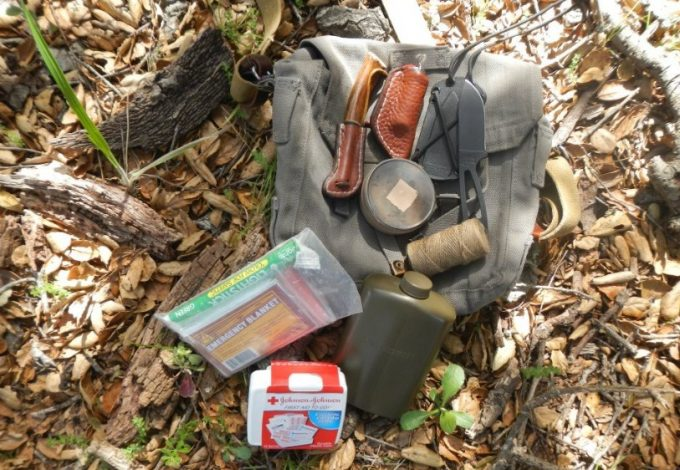 first aid kit backpack on the ground
