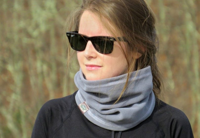 girl with neck gaiter and sunglasses