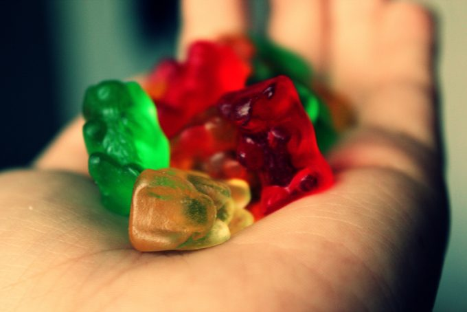 gummy bears in hand