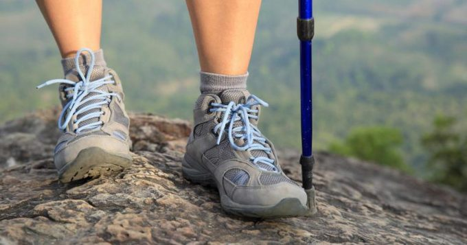 hiking boots and trekking pole