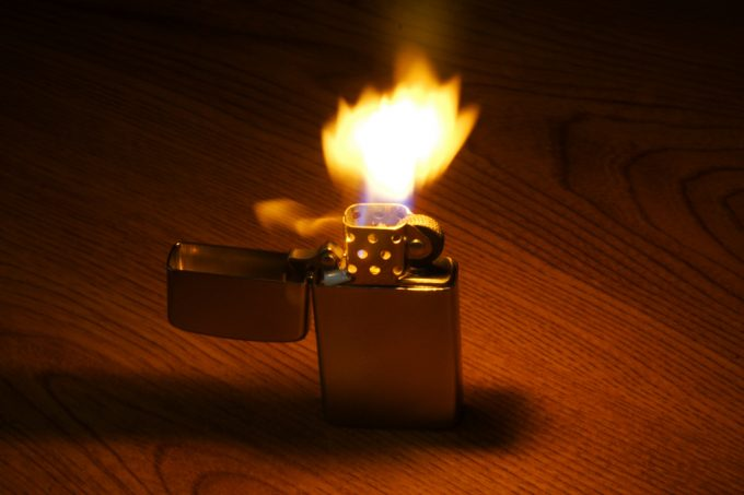 lighted zippo on a table