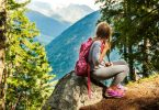 little girl hiking and resting