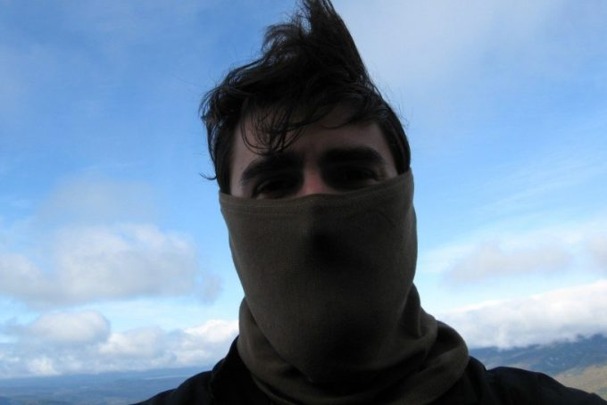 man with neck warmer