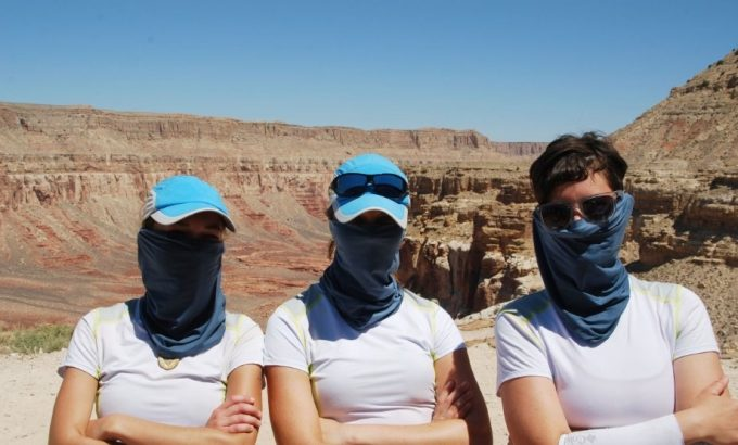 three women with neck gaiters