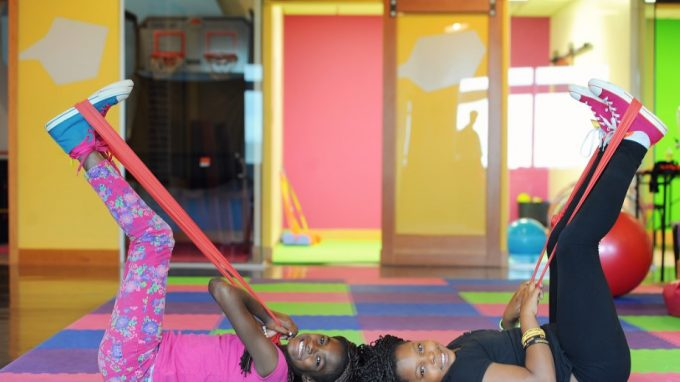 two girls exercising with resistance bands