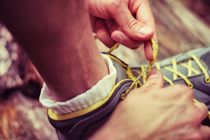 tying up hiking shoes