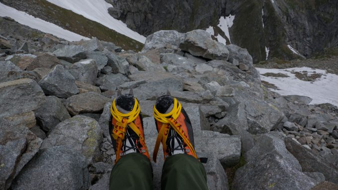 wearing mountaineering boots on the mountain