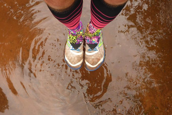with running gaiters in puddle