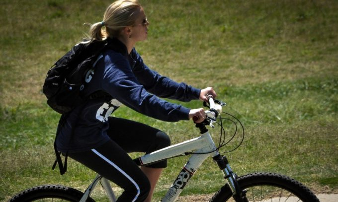 woman cycling in leggings