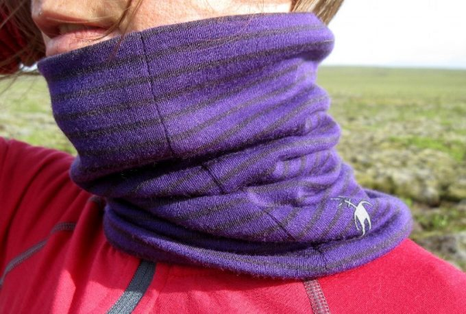 woman hiker with purple neck gaiter