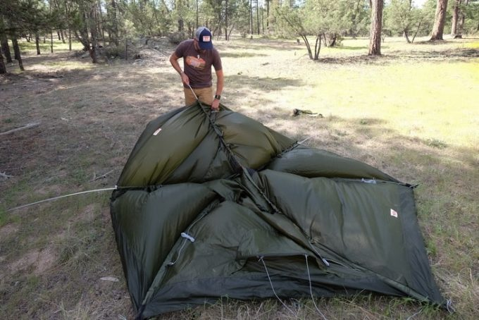 Setting up the tent in the nature