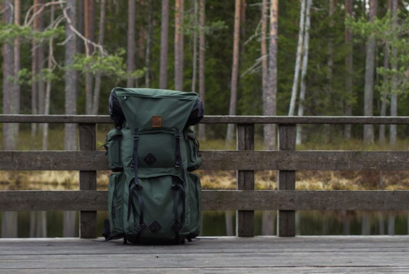 backpack on a wooden bridge