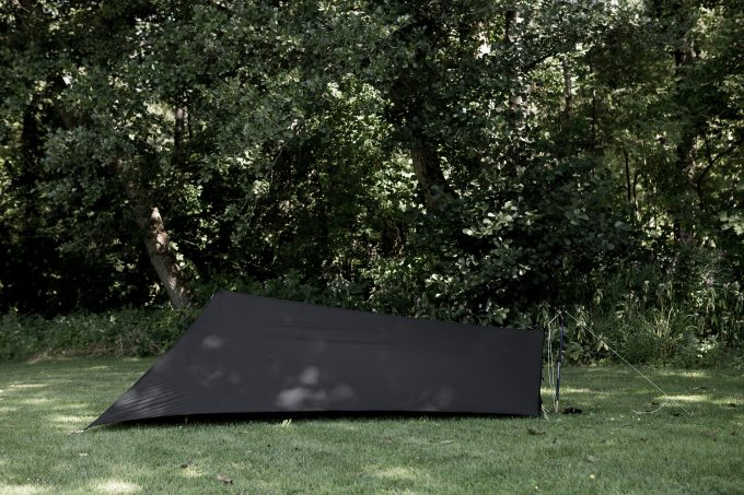 black tarp tent on grass