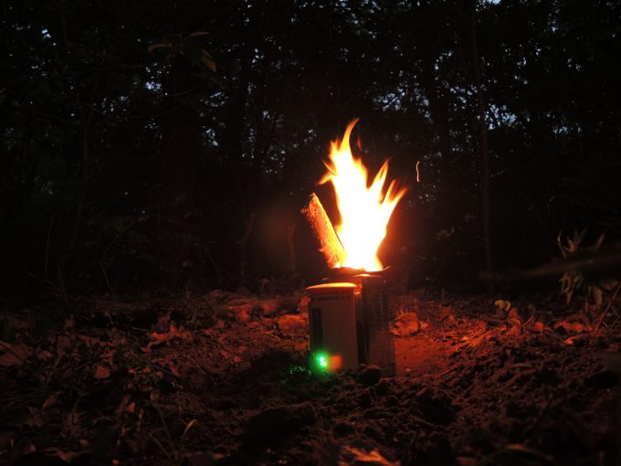 fired biolite stove in the dark