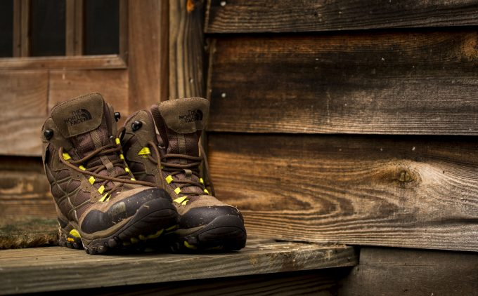 hiking boots wooden house