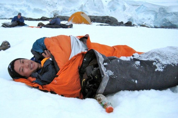 inside sleeping bag on the snow