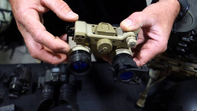 man holding night vision goggles