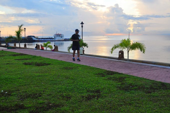 man jogging by the sea