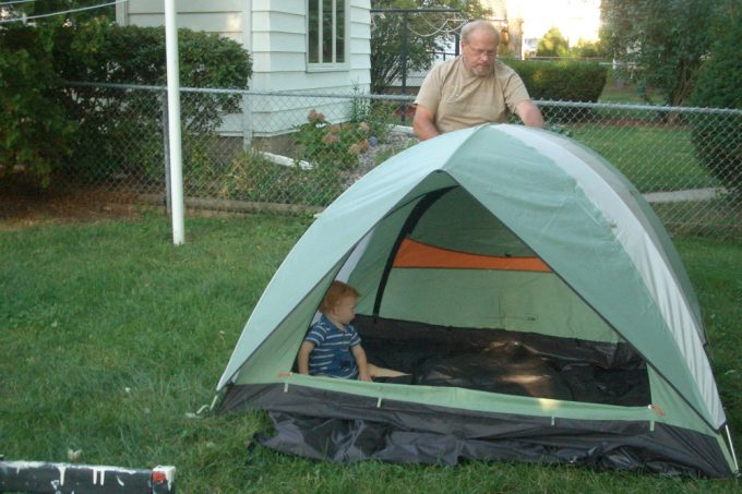 pitching a tent in the backyard
