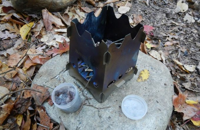 preparing to start a fire emberlit stove