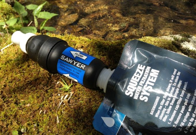 sawyer water filter next to water