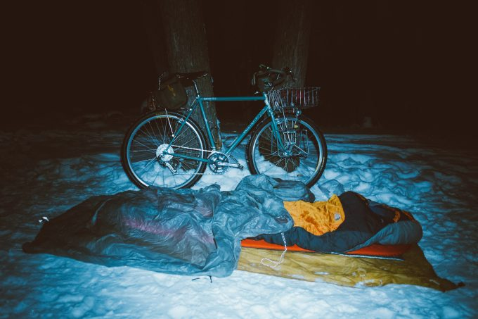 sleeping bag and bicycle on the snow