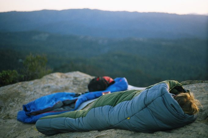 sleeping in sleeping bags on the rocks