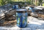 three bear canisters in the woods