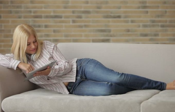 woman reading on couch
