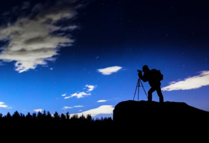 Photographer Silhouette At Night
