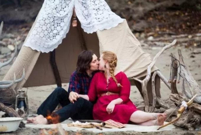 couple in front of tent kissing